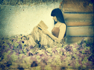 Woman reading book on the meadow. Old image style