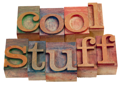 cool stuff - words in vintage, wooden letterpress printing blocks isolated on white