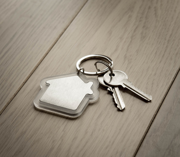 House keys with house keyring, on a natural background.